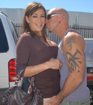 Horny couple in a parking lot